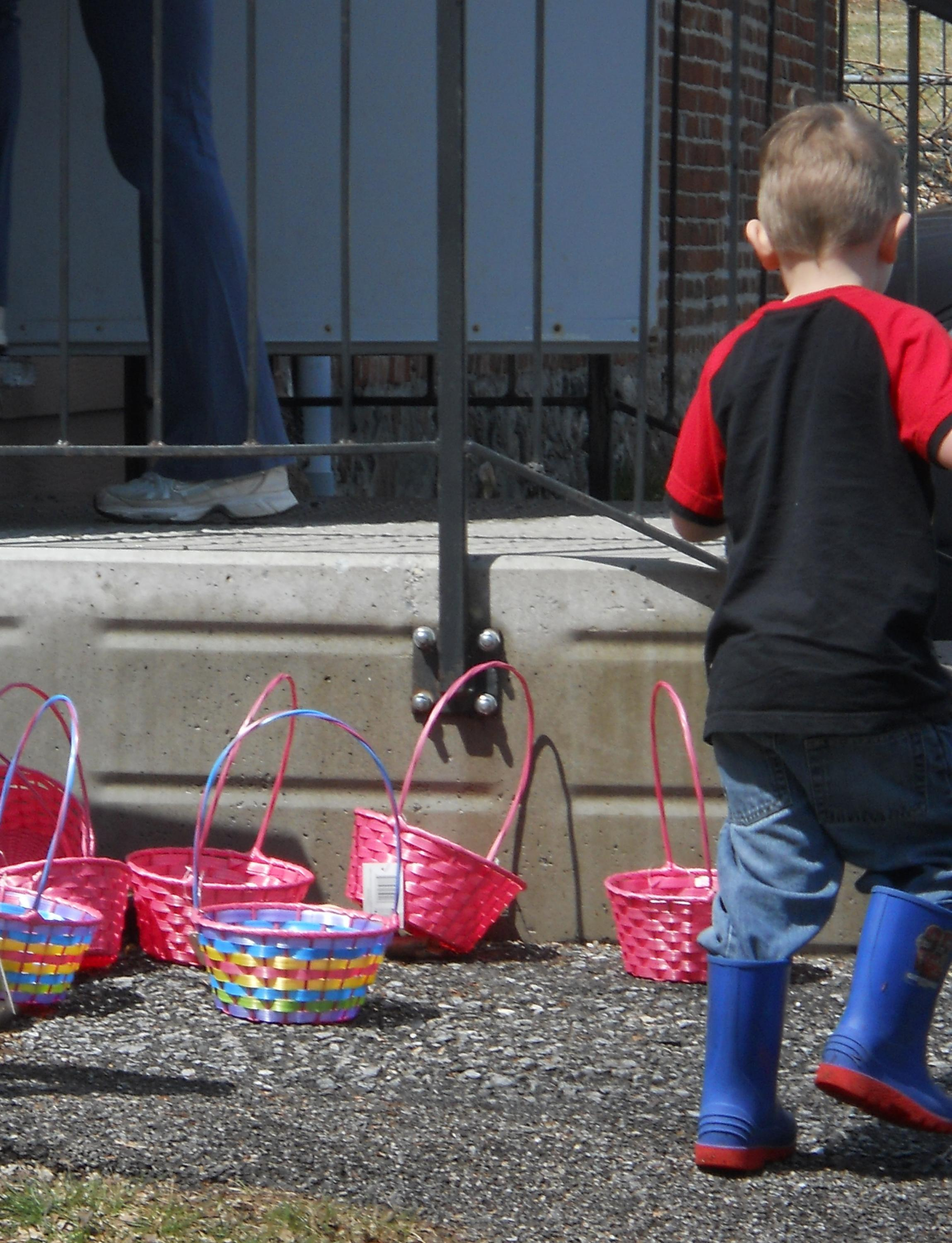 Easter egg baskets and children playing