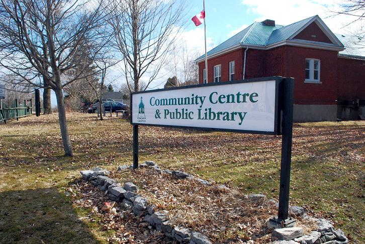 Front of Community Center building with sign that reads Community Centre and Public Library