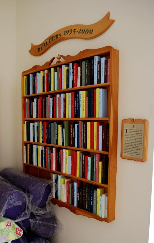 Nicely carved book shelf filled with books