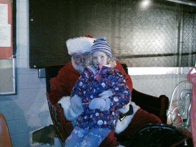 child sitting on santas lap