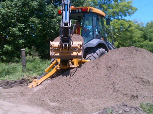 Machine digging digging dirt pile
