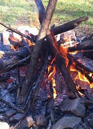 Wood pile burning in a controlled fashion